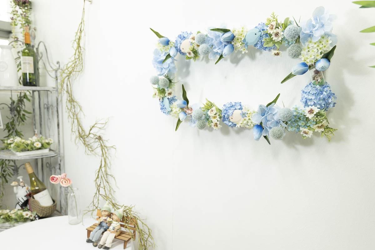 봉안당리스 부부단 여름 플라워오션 벽에 걸어둔 사진